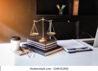 Workspace of lawery Judge gavel with Justice law at law firm in background.
