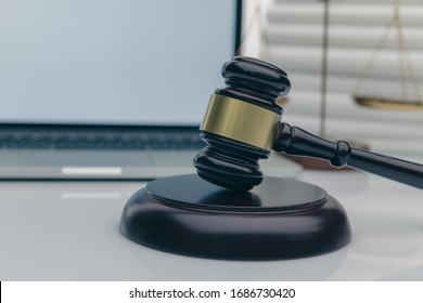 Workspace of lawyer with laptop blank white screen and law wooden gavel,legal book and brass scale of judge. lawyer and law ,judiciary and legislature courtroom legal concept.