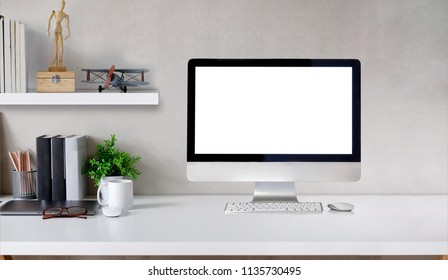Workspace with modern desktop computer and creative gadgets on table.