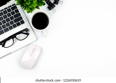 Workspace in office ,White desk with blank notebook and other office supplies,Top view with copy space.