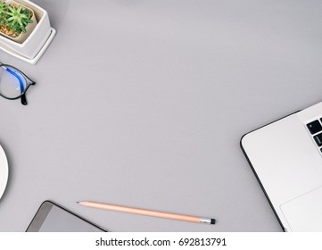 Workspace on gray color desk in Home studio with copy space for your design.Black coffee,Laptop and notebook top view flat lay design concept background.vintage tone.