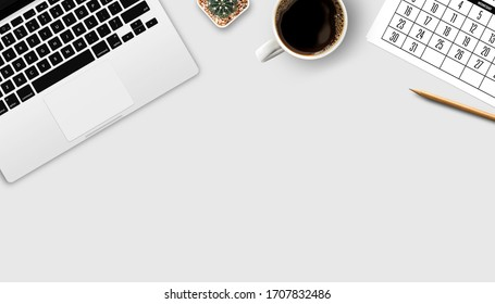 workspace with open laptop, documentation, and cup of black coffee on white table background. top view with copy space