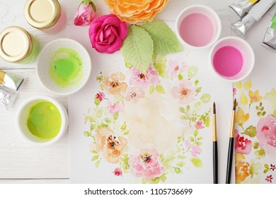 workspace. watercolor flowers drawing, artistic tools - brushes, watercolor paints. flat lay, Overhead view. top view