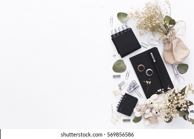 Workspace. Wedding planner. Decorations. Overhead view. Flat lay, top view. Copy space
