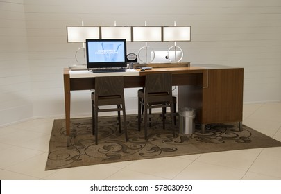 Workstation for hotel guests with comfortable seating and a desktop computer
