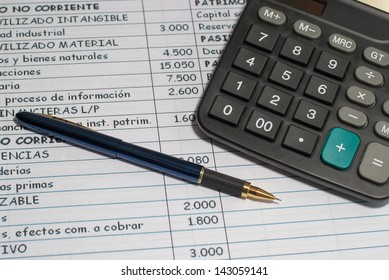 worktable leading business accounting ledger, pen and calculator