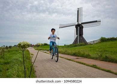 Workum, JULY 20: Chinese tourist cycling in Holland on 20 July, 2017 in Workum, The Netherlands. In year 2016 more than 300.000 Chinese tourists visited the Netherlands.