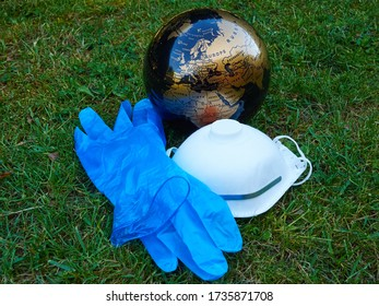 The world after the Coronavirus Global Pandemic - Covid-19 - A globe facing Europe and Africa with protection mask and gloves taken off