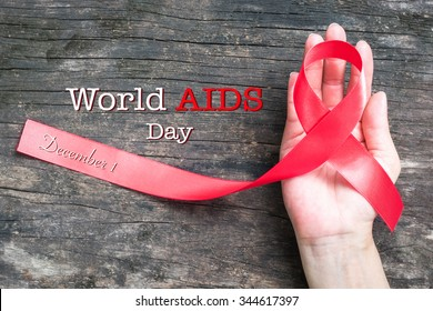 World aids day December 1 with red ribbon awareness campaign help people with living with HIV
