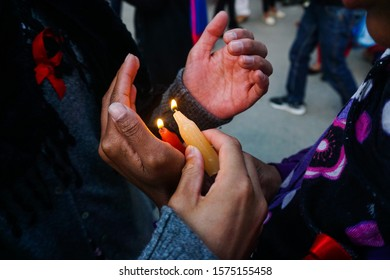 'World Aids Day'  Red ribbon candle light for awareness