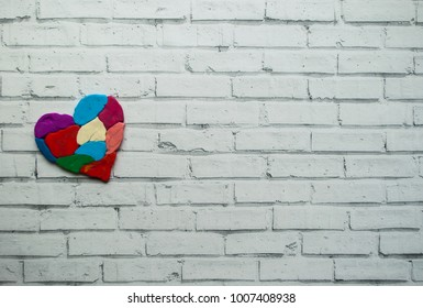 World autism awareness day. Autism awareness concept with colorful heart made of pieces on white background with text space.