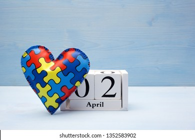 World Autism Awareness day, mental health care concept with puzzle or jigsaw pattern on heart with calendar