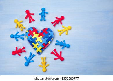 World Autism Awareness day, mental health care concept with puzzle or jigsaw pattern on heart with kids figures