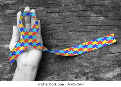 World Autism awareness and pride day with Puzzle pattern ribbon (isolated with clipping path)