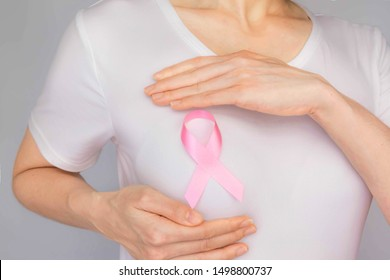 World Breast Cancer Day Concept,health care - woman wore white t-shirt,Pink ribbon for breast cancer awareness, symbolic bow color raising awareness on people living with women's breast tumor illness