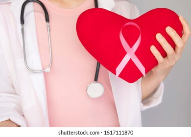 World Breast Cancer Day Concept,health care - Pink ribbon,Stethoscope,red heart for breast cancer awareness, symbolic bow color raising awareness on people living with women's breast tumor ill