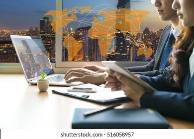 World business connection and global Network technology concept, Business meeting time. Financial managers with team and laptop on wood table