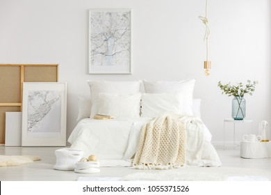 World cities map posters in a white minimalist master bedroom interior with scandinavian design furniture and accessories