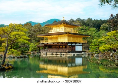 The world cultural heritage, Kinkaku Ji under morning sky, the traditional golden zen buddhist temple in Kyoto, Japan