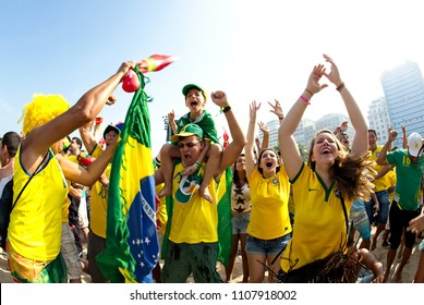 World Cup 2014, Rio de Janeiro, Brazil - June 28: Supporters celebrate at the Fifa Fan Fest area on Copacabana beach during a match high on emotion and drama between Brazil and Chile