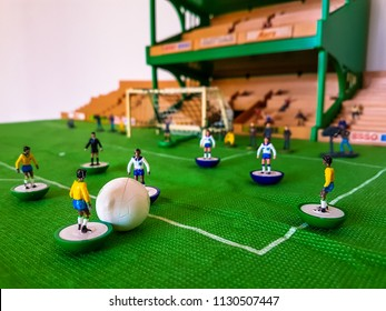 World Cup Subbuteo football figures lined up on a grass football field, England v Brazil