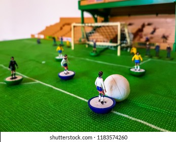 World Cup Subbuteo football figures lined up on a grass football field