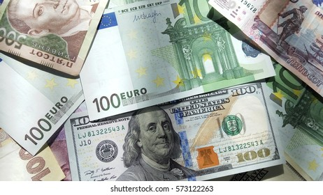 World currency closeup background. Image with US dollar, euro, ukrainian hryvna and russian ruble.