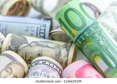 World currency trade / forex or international money exchange concept : Banknotes from world famous countries  e.g US USD dollar, Chinese renminbi / CNY yuan, European Union EU euro, Japanese JPY yen