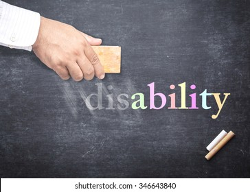 "World disable day concept: People hand holding eraser for change word ""disability"" to ""ability"""