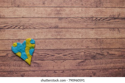 World Down syndrome day with blue yellow awareness day heart on wooden background with text space.