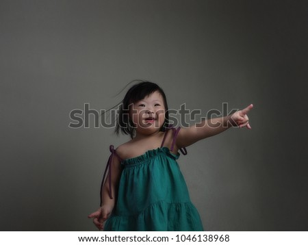 World Down Syndrome Day theme cheerful cute little Down syndrome girl  pointing her hand and finger 7fbec9ae6