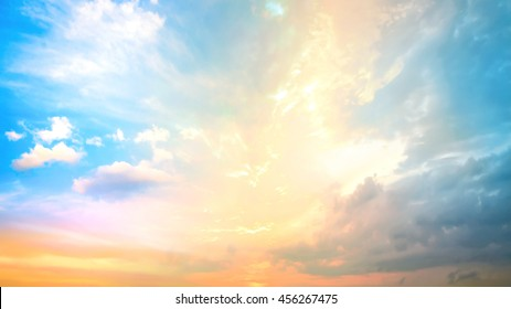 World environment day concept: Dramatic sun ray with orange sky and clouds dawn texture background