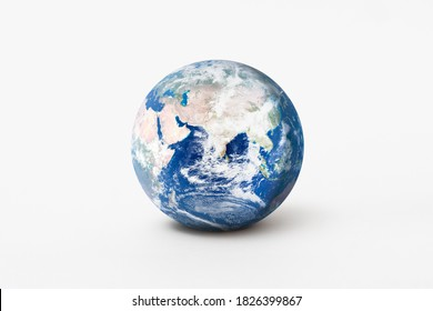 World environment day concept. Earth globe model with shadow on white background. Elements of this image furnished by NASA