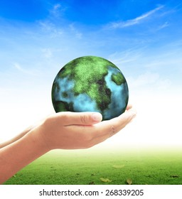 World environment day concept: Earth globe in human hands on nature background
