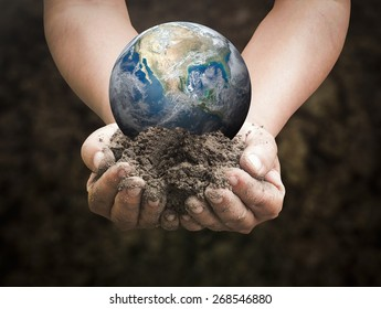World environment day concept: Earth globe in human hands on nature background. Elements of this image furnished by NASA