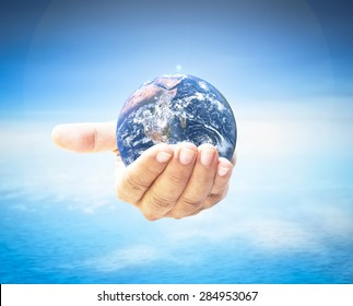 World environment day concept: Earth globe in hands. Elements of this image furnished by NASA