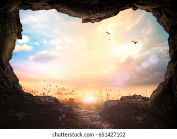 World environment day concept: Empty tomb stone and meadow sunrise landscape background