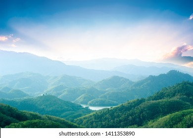 World Environment Day concept: Green mountains and beautiful sky clouds under the blue sky