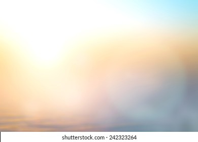 World environment day concept: Sun light and abstract blurry beach sunrise background
