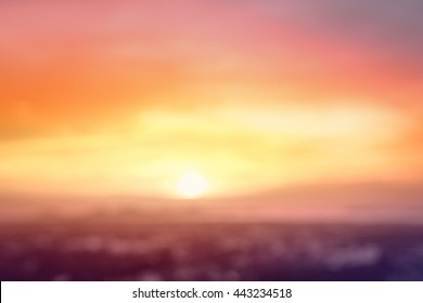 World environment day concept: Vintage style of abstract blur field on orange bokeh light mountain autumn sunset background