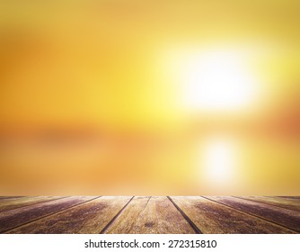 World environment day concept: Wooden table border with blurry beautiful sunlight and golden sunset background