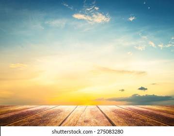 World environment day concept: Wooden table with colorful sunrise sky and clouds background