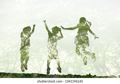world environment day concept.Double exposure kids jumping and playing on meadow and nature background