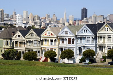 World famous Alamo Square and downtown San Francisco at the background