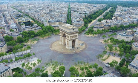 World famous Arc de Triomphe at the city center of Paris, France. Sky view