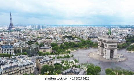 World famous Arc de Triomphe at the city center of Paris, France. Sky view