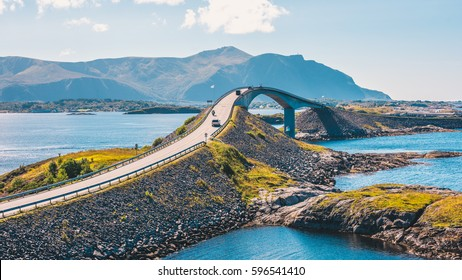 World famous Atlantic road bridge (Atlanterhavsvegen) with an amazing view over the norwegian mountains. Atlantic road runs through an archipelago in Eide and Averøy in Møre og Romsdal, Norway.