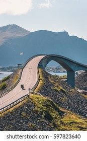 World famous Atlantic road bridge (Atlanterhavsvegen) with an amazing view over the norwegian mountains. Biker driving through an archipelago in Eide and Averøy in Møre og Romsdal, Norway.