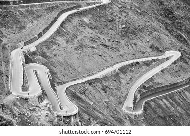 The world famous bends of the Stelvio Roads (Stelvio Pass), over the alps between Lombardy and Trentino, Northern Italy. Black and white photo.