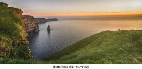 world famous cliffs of moher sunset landscape in county clare, ireland. vibrant irish rural countryside along the wild atlantic coast.  sunset coastal view from the west of ireland.